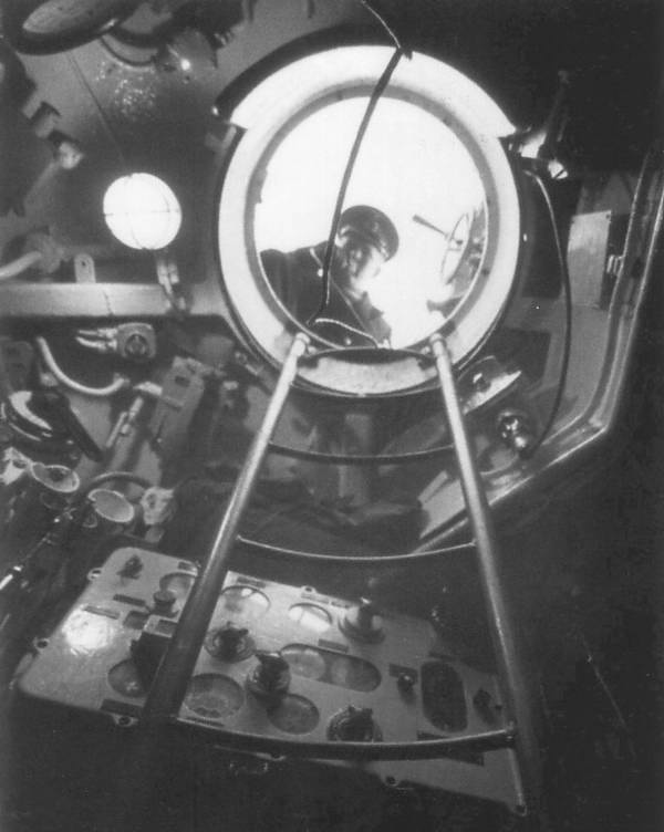 The torpedo data computer in a type VIIC U-Boat conning tower (most likely U 995, visible in the hatch is – most likely - Kptlt. Walter Köhntopp)