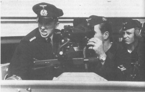 The operators of torpedo director on deck of German warship