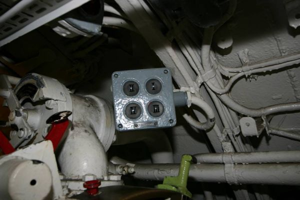 The control lamps in U 995's forward torpedo room