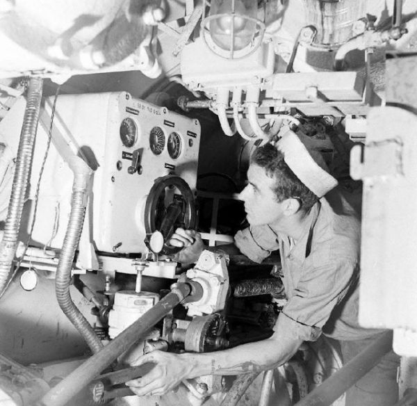 The gyro angle receiver (above the starboard torpedo tube) in U 234's aft torpedo room